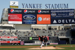 NEW YORK - APRIL 02:  Joba Chamberlain of the New York Yankees throws some warm up pitches during a Yankees workout at the new Yankee Stadium on April 2, 2009 in the Bronx borough of New York City.  (Photo by Ezra Shaw/Getty Images)
